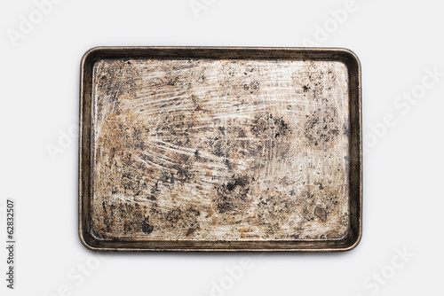 A well used, seasoned baking tray. Cookware. Baking sheet.
