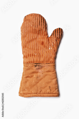 Used Oven Mitt. An orange fabric heat resistant mitt.