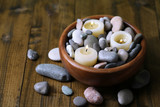 Composition with spa stones, candles on wooden background - 62832739