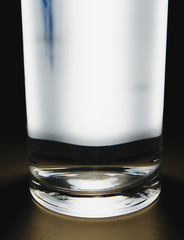 Light shining through glass of filtered water.