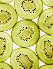 Organic kiwi slices, white background