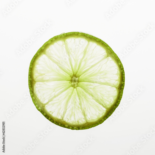 Organic lime slice on white background