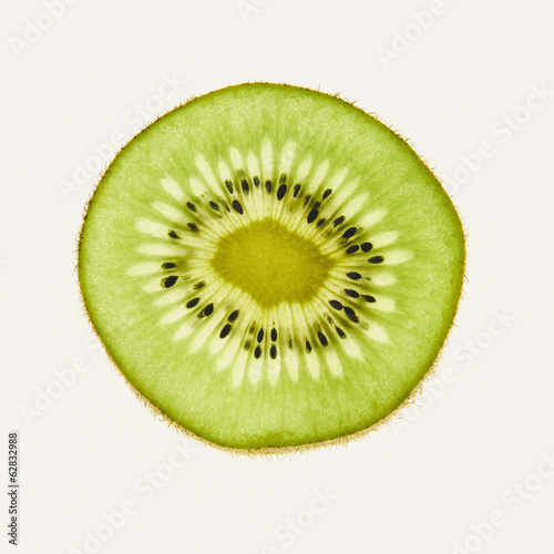 Organic kiwi slice, white background