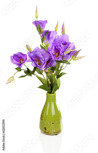 Purple artificial eustoma in vase isolated on white