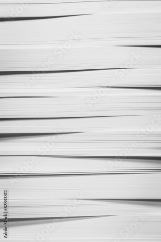 A stack of recycled white paper, paper supplies.