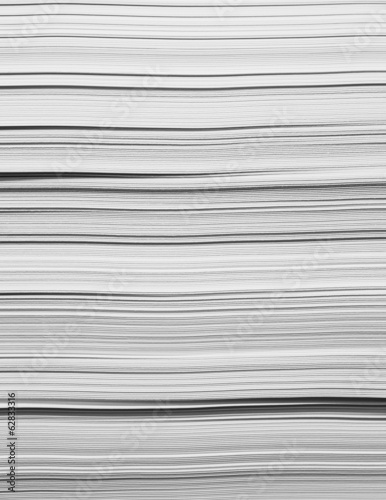 A stack of recycled white paper, paper supplies. The paper edges.