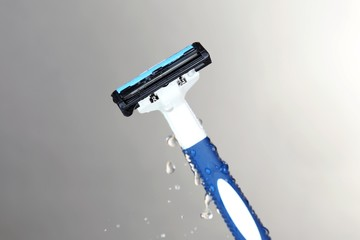 Men shaver on light grey background