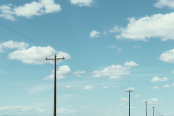 Telephone poles, power lines and cloudy sky, near Quincy