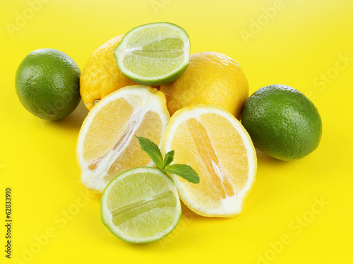 Lemons and limes, on yellow background