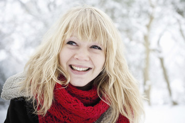 A young woman with blond hair in the snow.