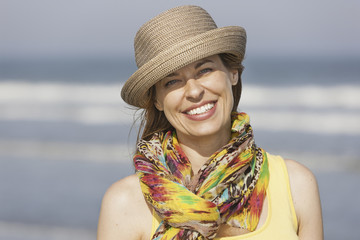 A woman in a sunhat and scarf on the beach on the New Jersey Shore, at Ocean City.