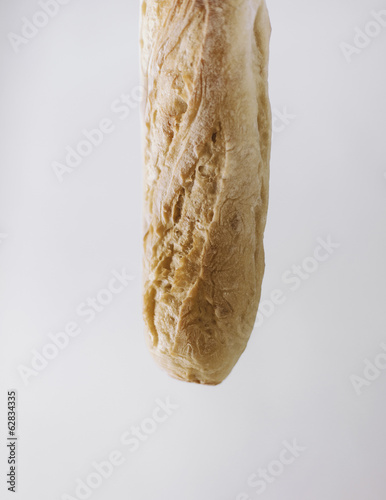 Close up of an organic baked sourdough baguette.