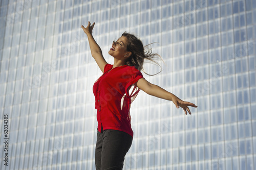 A beautiful young women on the boardwalk in Atlantic City, in front of a blue tiled wall.