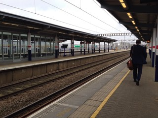 Londoner Commuter walking on a train platform