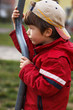 Little boy at outdoor with pole