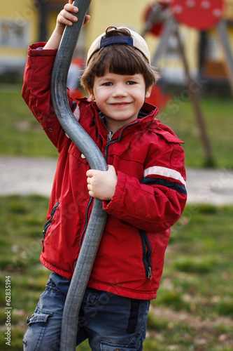 Little boy smile outdoor with pole