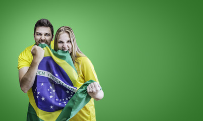 Brazilian fans celebrates on green background
