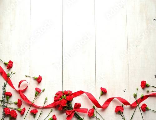 Red carnations bouquet with ribbon