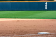 Empty baseball field highlights first base and outfield wall - 62837321