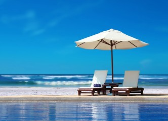 Two Chairs with White Umbrella near the Beach