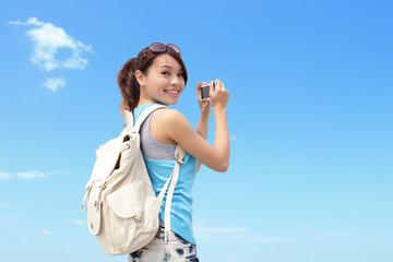 Happy woman traveler photo by camera