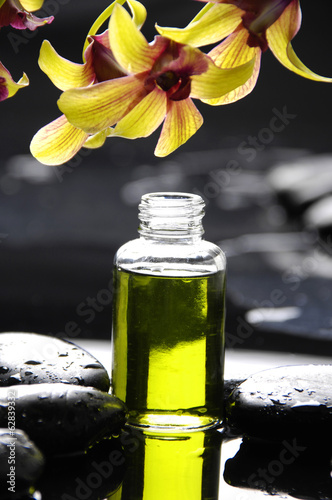 Poster Spa Still life with orchid ,massage oil, candle and zen stones
