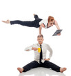 Businessmen - acrobats isolated on white backdrop