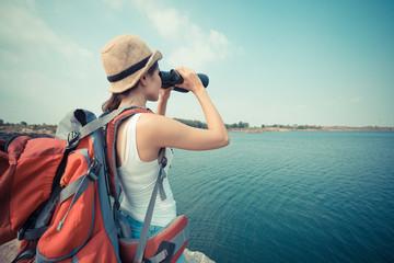With binoculars