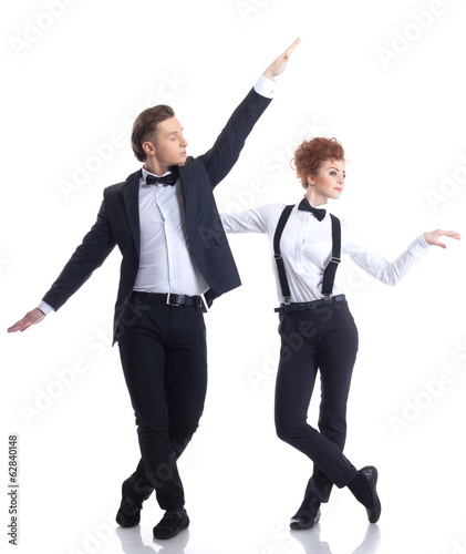 Artistic young businessmen dancing in studio