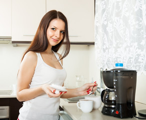 girl   making coffee.