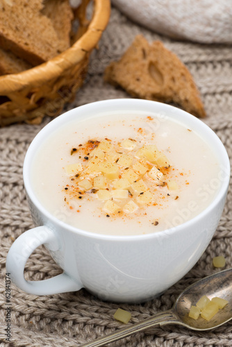 cream soup of cauliflower with cheese and pepper, vertical
