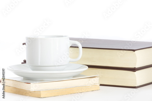 Composition with books and cup of coffee isolated on white
