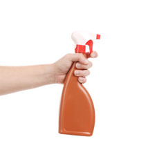 Hand holding brown plastic spray bottle.