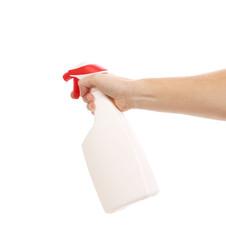 Hand holding white plastic spray bottle.
