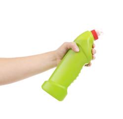Hand holding green bottle.