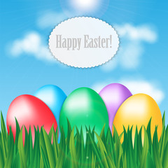 Colorful Easter eggs on green grass on blue sky background and f