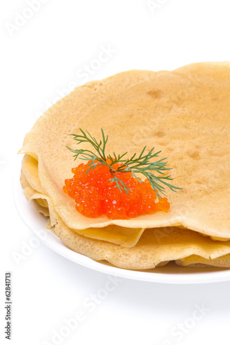 stack of crepes with red caviar on a plate, isolated