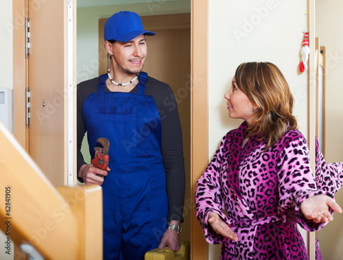 Middle-aged woman meeting worker