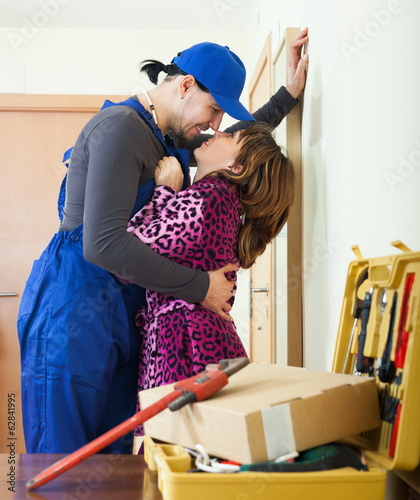 Playful plumber flirting with housewife