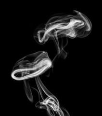 white smoke isolated on a black background