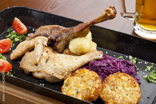 Baked duck and chicken legs