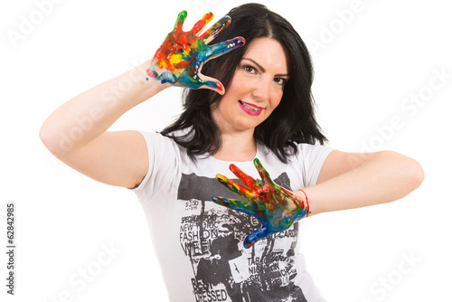 Woman showing hands in colorful paints