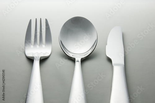 Metal spoon, fork and knife.