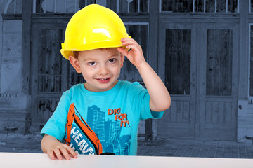 Child with hard hat on the construction site