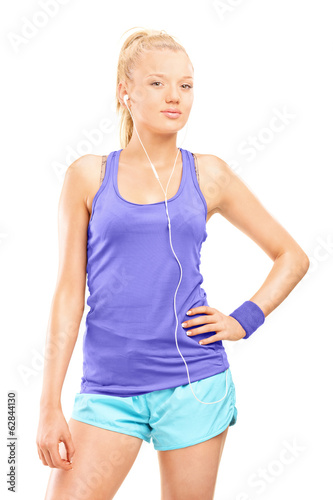 Blond girl listening to a music on headphones
