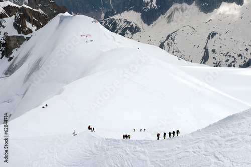 Teams of climbers in mountains near Mont Blanc