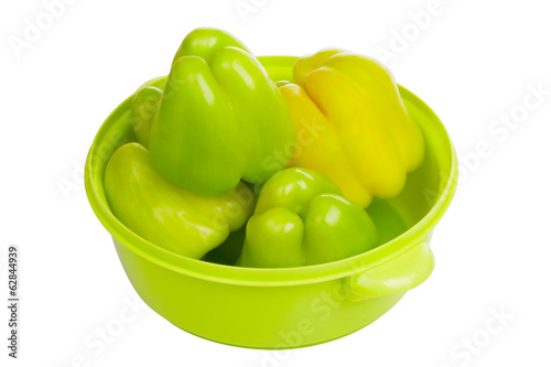 Some green peppers in a light green bowl