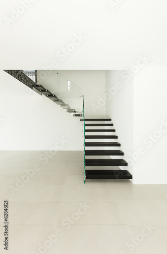 Interior, modern staircase in empty house.