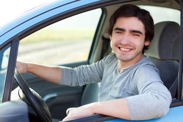 Portrait of an attractive man in his car