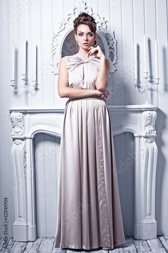 High fashion shot of young beautiful woman in gorgeous silk dres